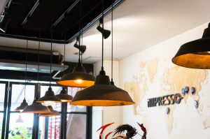 Black light fixtures and world map at impresso espresso bar, chiang mai thailand
