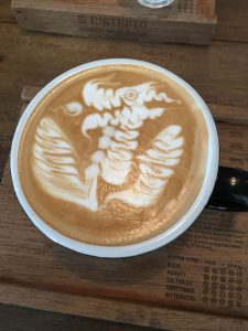 a cappuccino with dragon latte art at Ristr8to coffee in chiang mai, thailand