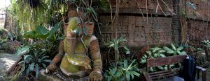 clay ganesh statue covered in vines and moss in Chiang Mai, Thailand