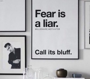 a picture frame with bold text that says Fear is a Liar, call its bluff.