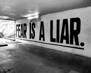 text mural that reads fear is a liar in all caps