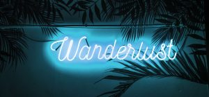 "A neon sign in Chiang Mai, Thailand that reads ""wanderlust""."