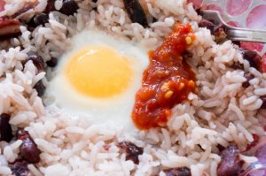 red beans and rice with an egg on top makes an easy meal while traveling