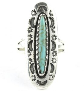 accessorize with a minimal turquoise ring to keep your minimal travel wardrobe simple